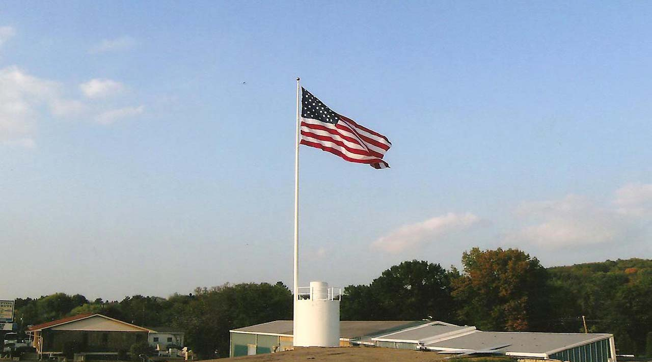 American Flag flying overtop of Hampton Concrete Products, Inc. main showroom